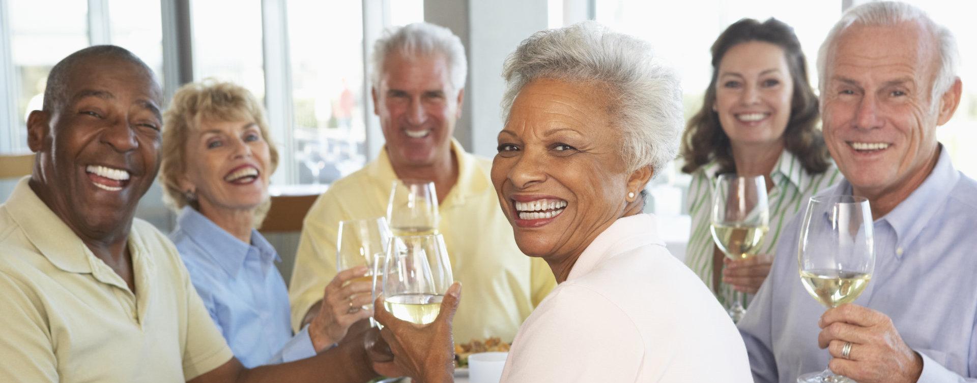 group of elderly having champagne toast