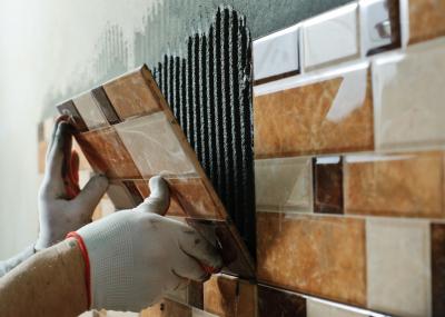 tiler placing wall tile
