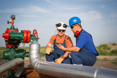 oil workers on the oil pump jack